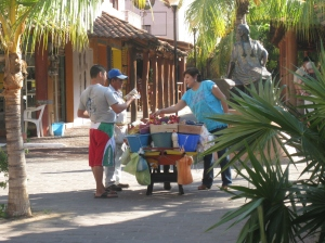Fruit vendor making a sale