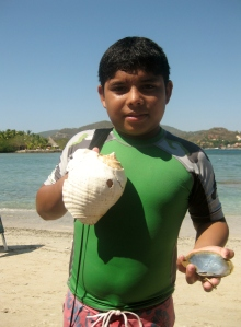 Young boy selling the shells he had been diving for