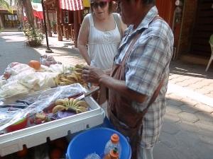 Sylvia buying bananas