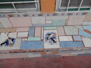 Mosaic bench in front of shop