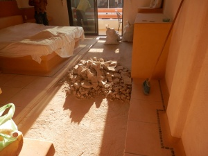 Our room after pulling tiles and grout