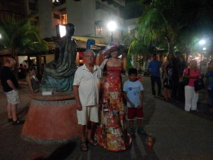 The senor with a lady in a dress made completely of candy wrappers