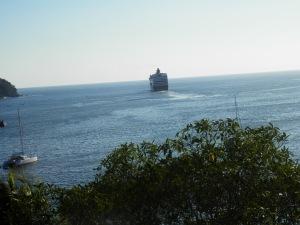 cruise ship leaving Zihuatanejo Bay