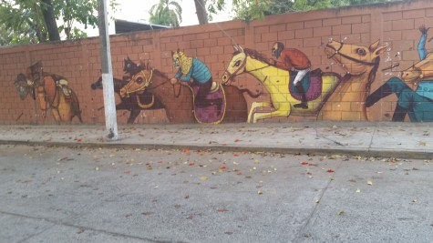 Horse race mural on wall coming back from the pool