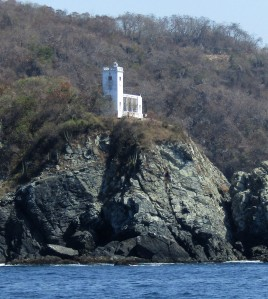 Sailing past Zihuatanejo's lighthouse